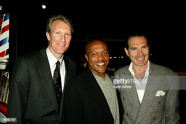 MGM's Chris McGurk Alex Yemenidjian pose with director Kevin Sullivan at the premiere of MGM's 'Barbershop 2 Back in Business' at the Chinese Theatre...