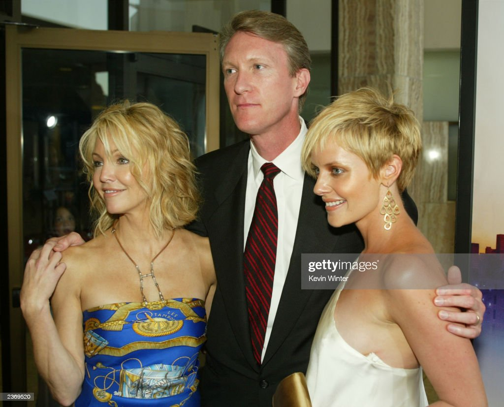 MGM's Chris McGurk, Heather Locklear and Marley Shelton attend the MGM Pictures Los Angeles premiere of the film 'Uptown Girls' at the ArcLight Cinerama Dome August 4, 2003 in Hollywood, California.