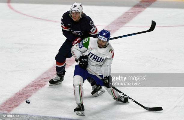 USA's Christian Dvorak and Italy´s Tommaso Traversa vie during the IIHF Ice Hockey World Championships first round match between USA and Italy in...