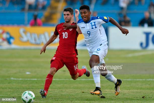 USA's Christian Pulisic and Honduras' Anthony Lozano vie for the ball during their 2018 World Cup qualifier football match in San Pedro Sula Honduras...