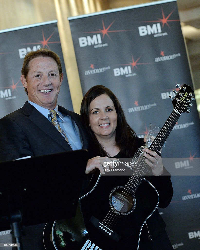 BMI's Clay Bradley honors co-writer Lori McKenna with a BMI guitar as BMI and Hunter Hayes celebrate their No. 1 Song 'I Want Crazy' at the BMI offices In Nashville on October 8, 2013 in Nashville, Tennessee.