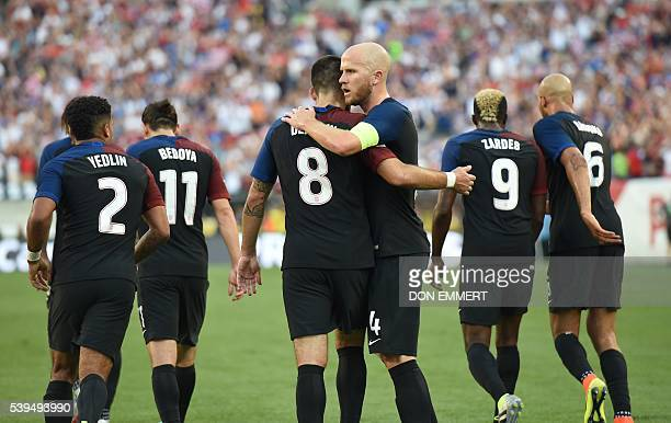 USA's Clint Dempsey celebrates with teammate Michael Bradley after scoring against Paraguay during the Copa America Centenario football tournament in...