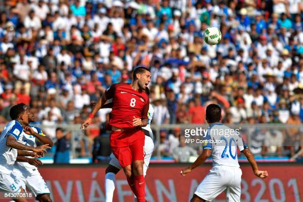 USA's Clint Dempsey jumps for a header during the 2018 World Cup qualifier football match against Honduras in San Pedro Sula Honduras on September 5...