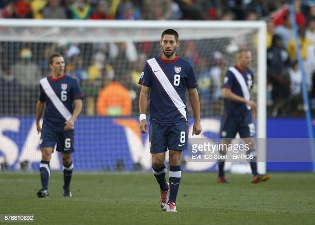USA's Clinton Dempsey and his team mates apper dejected after Slovenia's Valter Birsa scored the opening goal