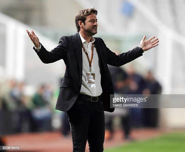 APOEL's coach Thomas Christiansen gestures to his playesr during the UEFA Europa League football match between Cyprus' APOEL of Nicosia and...