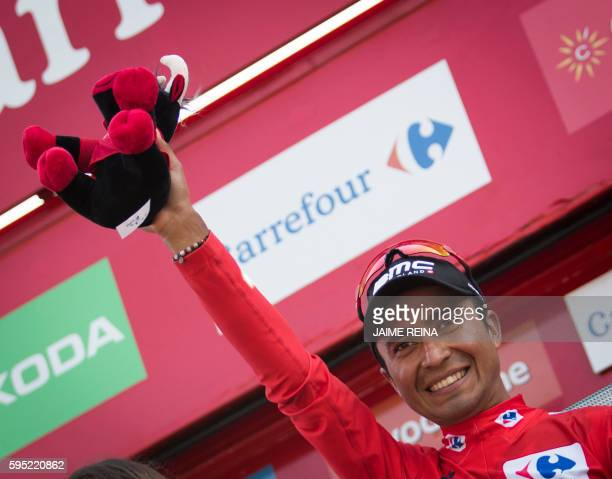 BMC's Colombian cyclist Darwin Atapuma celebrates on the podium after retaining the red jersey after the 6th stage of the 71st edition of 'La Vuelta'...