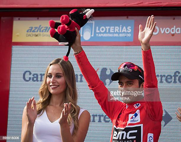 BMC's Colombian cyclist Darwin Atapuma celebrates on the podium after retaining the red jersey during the 7th stage of the 71st edition of 'La...