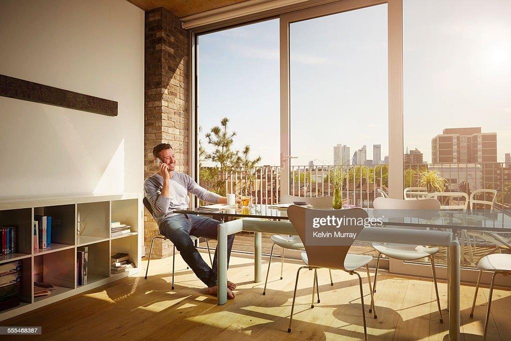 40's Couple In Apartment : Stock Photo