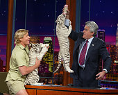TV's 'Crocodile Hunter' Steve Irwin appears with baby white tigers on 'The Tonight Show with Jay Leno' at the NBC studios February 4 2003 in Burbank...