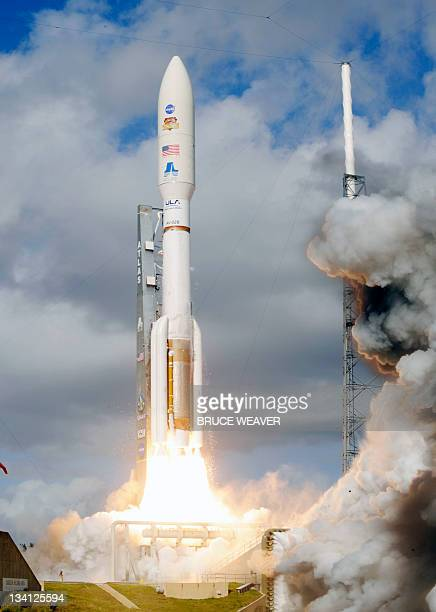 NASA's Curiosity rover formally known as the Mars Science Laboratory heads for space on November 26 2011 atop an Atlas 5 rocket from launch pad 41 at...
