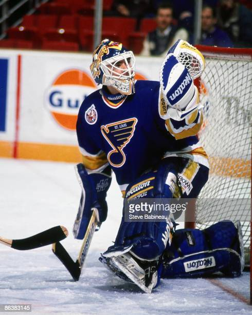 HARTFORD CT 1990's Curtis Joseph of the St Louis Blues makes glove save against the Hartford Whalers