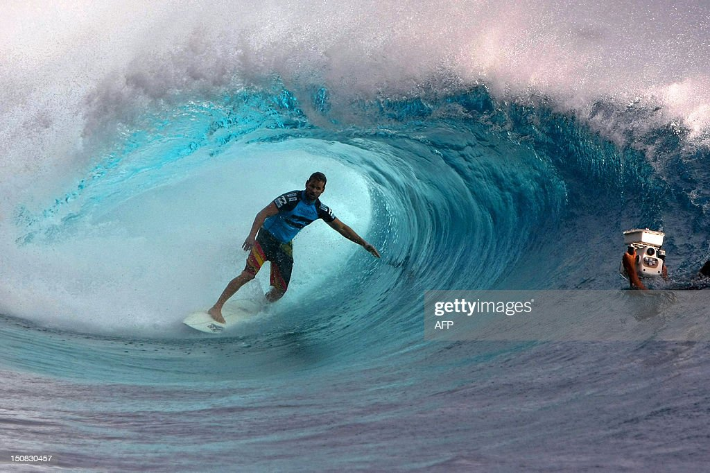 USA's Damien Hobgood competes during his round one heat at the Billabong Pro Tahiti in the southern Pacific ocean island of Tahiti French Polynesia...