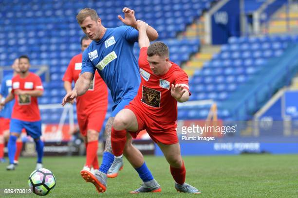 TOWIE's Dan Osborne in action with Eastender's Danny Boy Hatchard during the Celebrity Charity Football Match at King Power Stadium on May 28 2017 in...