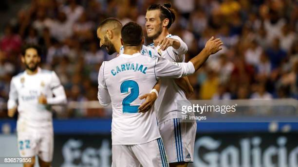 s Dani Carvajal of Real Madrid Karim Benema of Real Madrid and Gareth Bale of Real Madrid celebrate a goal during the La Liga match between Deportivo...