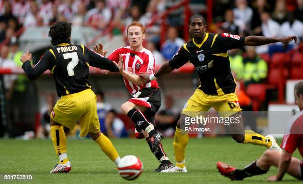 QPR's Daniel Parejo and Mikele Leigertwood tackles Sheff Utd's Stephen Quinn during the CocaCola Football Championship match at Bramall Lane Sheffield