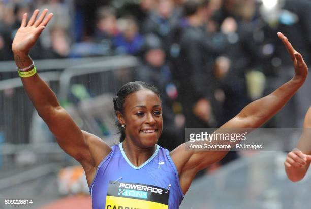 USA's Danielle Carruthers celebrates winning the Women's 100m Hurdle race during the Great City Games Manchester