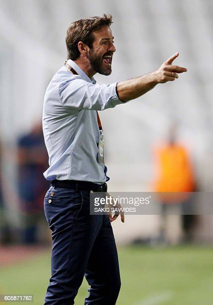 APOEL's Danish coach Thomas Christiansen instructs his players during their UEFA Europa League Group B football match between Cyprus' APOEL Nicosia...