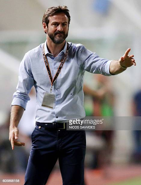 APOEL's Danish coach Thomas Christiansen instructs his team during their UEFA Europa League Group B football match between Cyprus' APOEL Nicosia and...