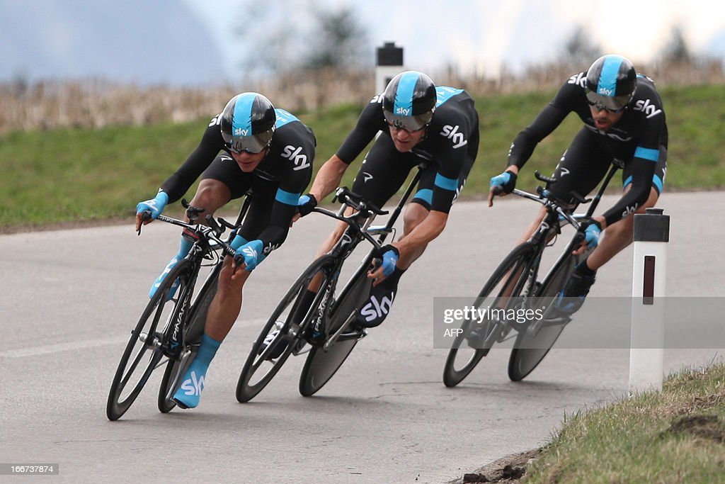 US's Danny Pate, Britain's Bradley Wiggins and Italia's Dario Cataldo of Sky Procycling Team compete during the 14,1 km Team Time Trial of the cycling road race 'Giro del Trentino' in Lienz, Austria, on April 16, 2013.