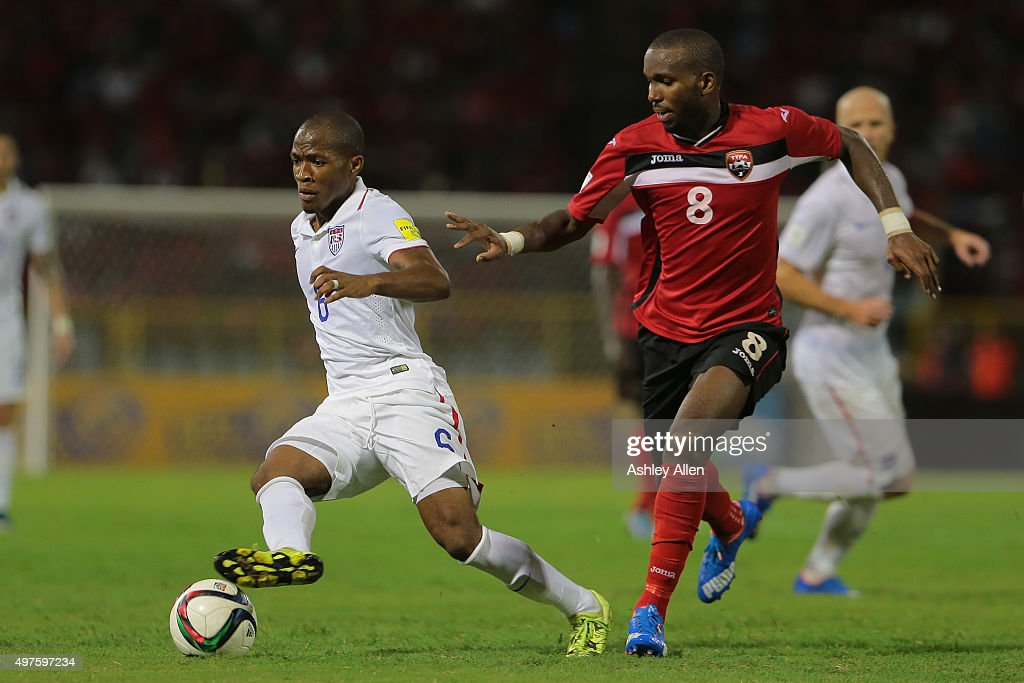 USA's #6 <a gi-track='captionPersonalityLinkClicked' href=/galleries/search?phrase=Darlington+Nagbe&family=editorial&specificpeople=6588276 ng-click='$event.stopPropagation()'>Darlington Nagbe</a> runs into the final third of the field as Trinidad and Tobago's # 8 <a gi-track='captionPersonalityLinkClicked' href=/galleries/search?phrase=Khaleem+Hyland&family=editorial&specificpeople=5366394 ng-click='$event.stopPropagation()'>Khaleem Hyland</a> battles for the ball during a World Cup Qualifier between Trinidad and Tobago and USA as part of the FIFA World Cup Qualifiers for Russia 2018 at Hasely Crawford Stadium on November 17, 2015 in Port of Spain, Trinidad & Tobago.