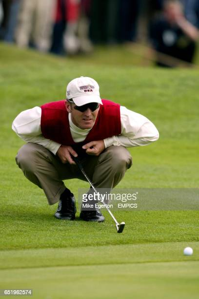USA's David Duval lines up his put during his match against Europes' Nichlas Fasth and Jesper Parnevik