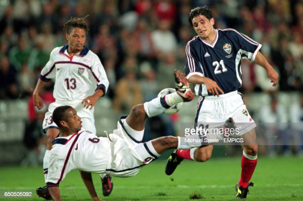USA's David Regis attempts to clear the ball from Yugoslavia's Perica Ognjenovic