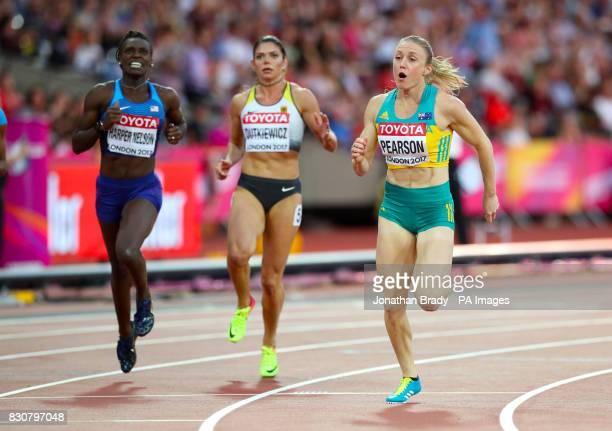 USA's Dawn Harper Nelson Germany's Pamela Dutkiewicz and Australia's Sally Pearson cross the finish line after winning the Women's 100m Hurdles...