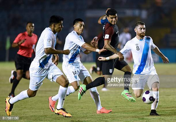 USA's De Andre Yedlin kicks the ball as Guatemala's Moises Hernandez Rafael Morales and Jean Marquez mark him during their Russia 2018 FIFA World Cup...