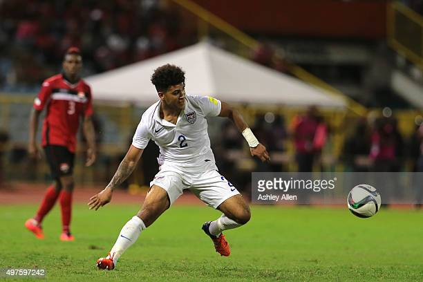 USA's DeAndre Yedlin brings the ball under control as TT's Joevin Jones looks on during a World Cup Qualifier between Trinidad and Tobago and USA as...