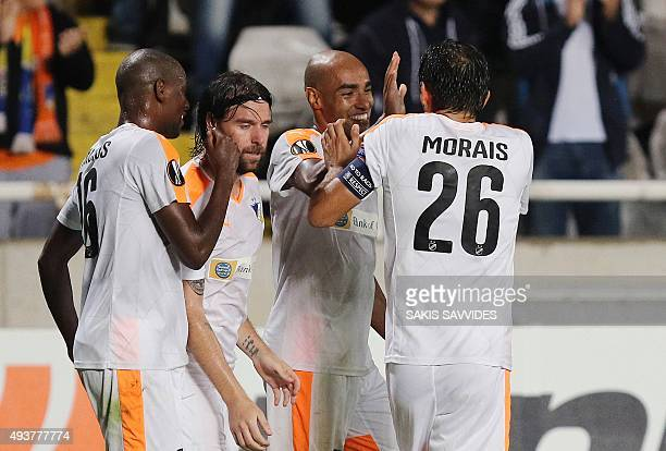 APOEL's defender Carlao is congratulated by his tammates after scoring his teams second goal during the UEFA Europa League football match between...