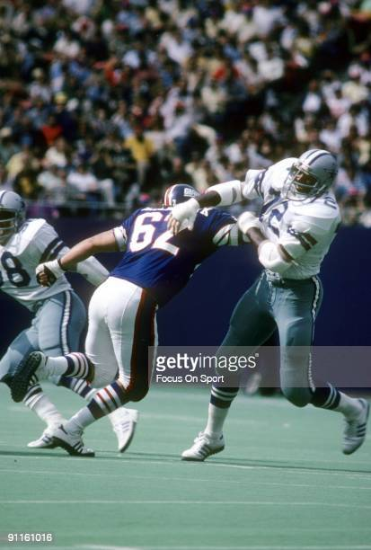 RUTHERFORD NJ CIRCA 1980's Defensive end Ed Jones of the Dallas Cowboys is blocked by Doug Riesenberg of the New York Giants during an NFL football...