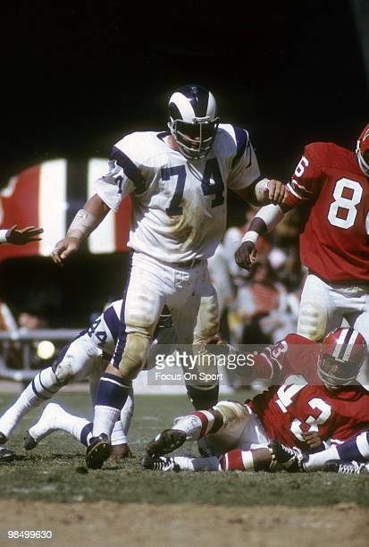ATLANTA GA CIRCA 1970's Defensive Tackle Merlin Olsen of the Los Angeles Rams is in action standing over running back Dave Hampton of the Atlanta...