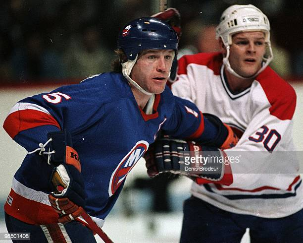MONTREAL 1980's Denis Potvin of the New York Islanders skates against Richard Meagher of the Montreal Canadiens in the 1980's at the Montreal Forum...