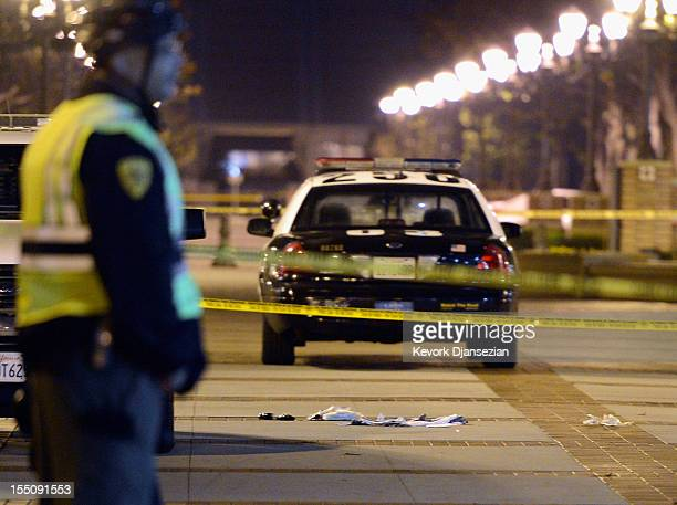 USC's Department of Public Safety officer secure the crime scene after four people were shot including one in critical condition during a Halloween...