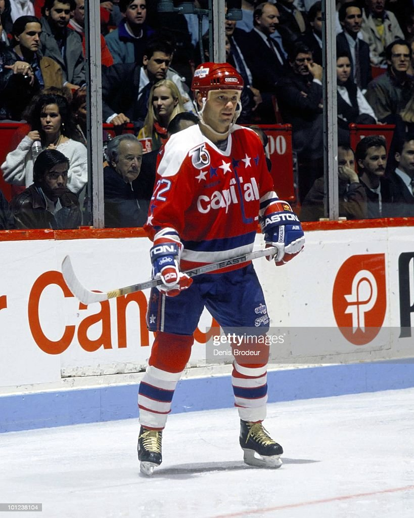 MONTREAL - 1980's: Dino Cicarelli #22 of the Washington Capitals skates against the Montreal Canadiens in the 1980's at the Montreal Forum in Montreal, Quebec, Canada.