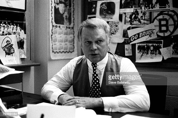 BOSTON MA 1970's Don Cherry coach of the Boston Bruins address media from his desk at Boston Garden