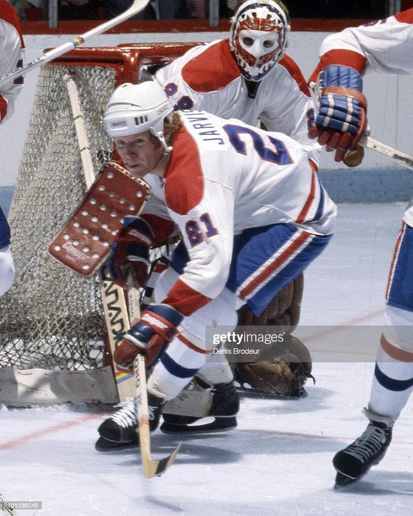 MONTREAL - 1970's: Doug Jarvis #21 of the Montreal Canadiens skates in the 1970's at the Montreal Forum in Montreal, Quebec, Canada. Jarvis played for the Canadiens from 1975-1982.