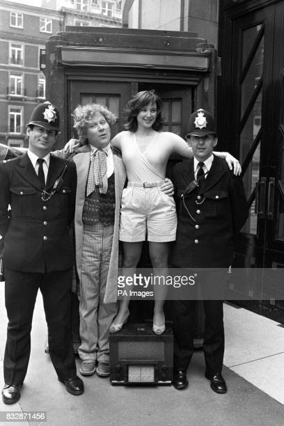 BBC's Dr Who actor Colin Baker and his assistant Peri played by Nicola Bryant with two police officers outside the Tardis A special Dr Who story of...