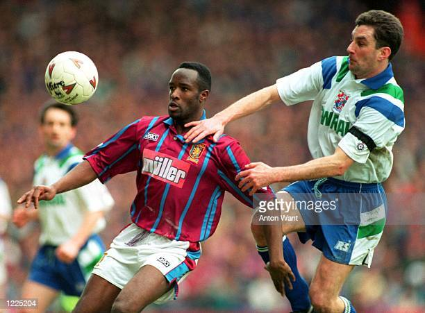 VILLA's EARL BARRETT EYES THE BALL BUT IS HELD BACK BY TRANMERE ROVERS'' JOHN ALDRIDGE IN THEIR COCACOLA CUP SELIFINAL MATCH TODAY VILLA WON THE...
