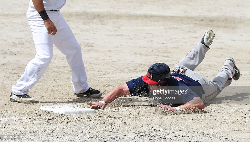 USA's Eddie Keteluhut dives for third base during the pool match between USA and South Africa at Rosedale Park, Albany on March 3, 2013 in Auckland, New Zealand.