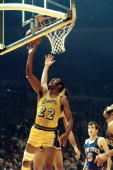 LOS ANGELES 1970's Elgin Baylor of the Los Angeles Lakers goes for a layup against the New York Knicks during the NBA game at the Forum circa 1970's...