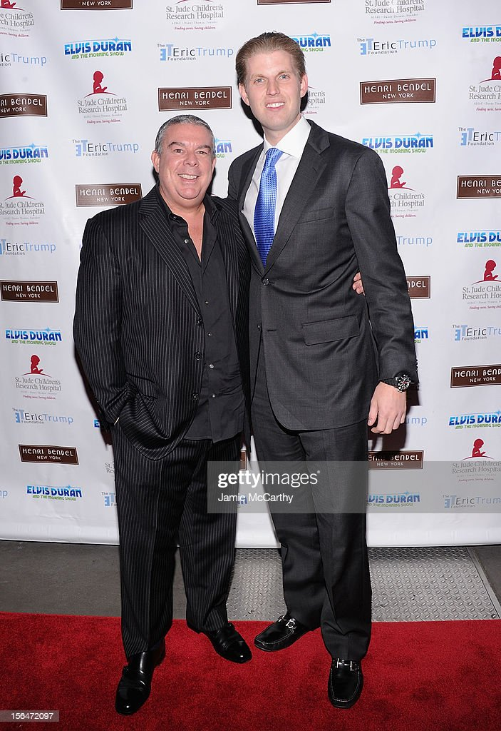 Z100's Elivs Duran and <a gi-track='captionPersonalityLinkClicked' href=/galleries/search?phrase=Eric+Trump&family=editorial&specificpeople=1283906 ng-click='$event.stopPropagation()'>Eric Trump</a> attend Henri Bendel holiday window unveiling 2012 at Henri Bendel on November 15, 2012 in New York City.