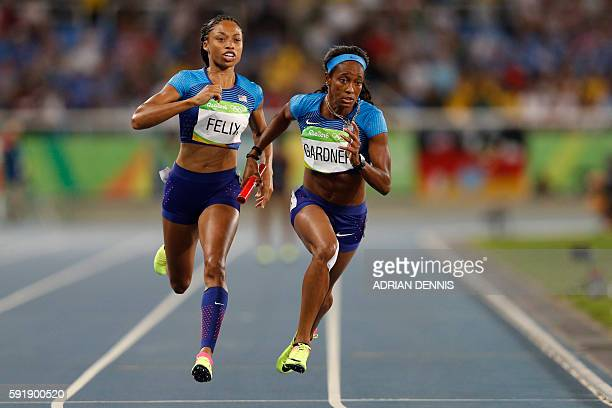 TOPSHOT USA's English Gardner grabs the baton from USA's Allyson Felix as they compete in the Women's 4 x 100m Relay Round 1 rerun during the...