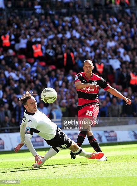 QPR's English striker Bobby Zamora scores the winning goal past Derby County's Irish defender Richard Keogh during the English Championship Play Off...