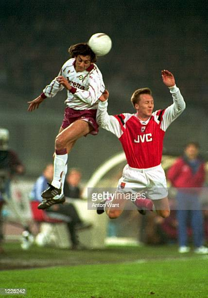 TORINO's ENZO FRANCESCOLI OUTJUMPS ARSENAL's LEE DIXON DURING THE EUROPEAN CUP WINNERS CUP FIRST LEG MATCH BETWEEN TORINO V ARSENAL IN TURIN THE...