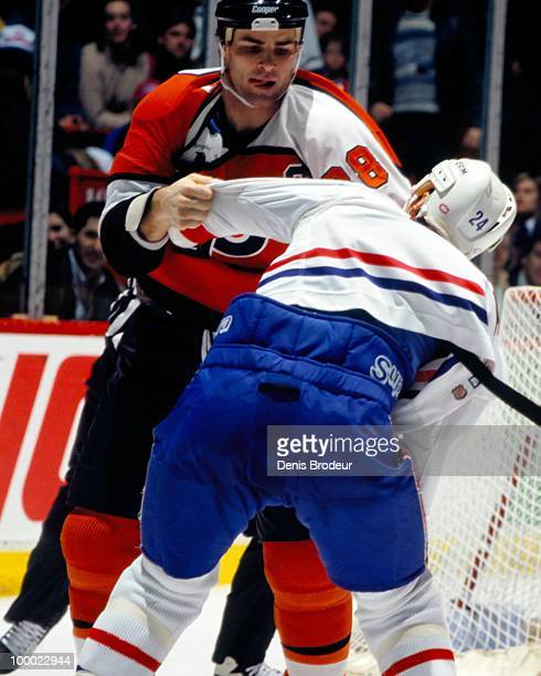 MONTREAL 1990's Eric Lindros of the Philadelphia Flyers fights with a player on the Montreal Canadiens in the early 1990's at the Montreal Forum in...
