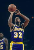 PISCATAWAY NJ CIRCA 1980's Ervin Magic Johnson of the Los Angeles Lakers shoots a freethrow against the New Jersey Nets during a circa 1980's NBA...