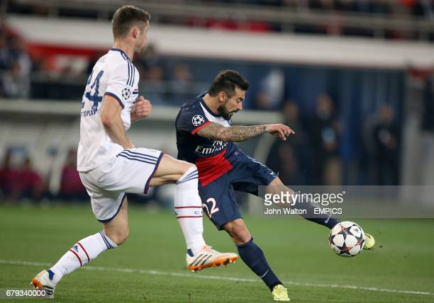PSG's Ezequiel Lavezzi has a shot on goal under pressure from CHelsea's Gary Cahill