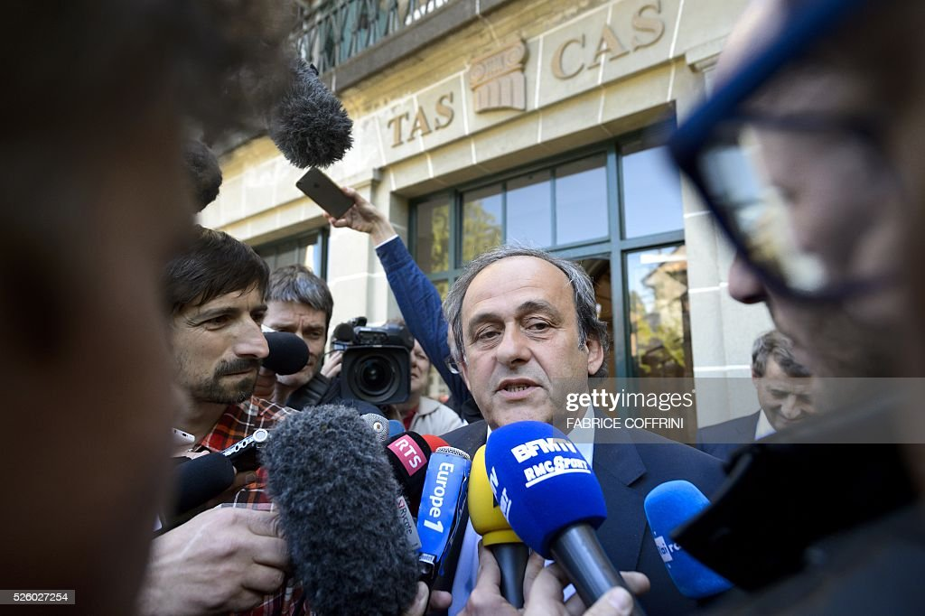 UEFA's fallen chief Michel Platini addresses the media as he leaves the Court of Arbitration for Sport (CAS) after his appeal hearing against his six-year FIFA ban for ethics violations, on April 29, 2016 in Lausanne. CAS will rule on Michel Platini's appeal against his six-year FIFA ban by May 9, the head of the Lausanne-based tribunal Mathieu Reeb said on April 29. / AFP / FABRICE