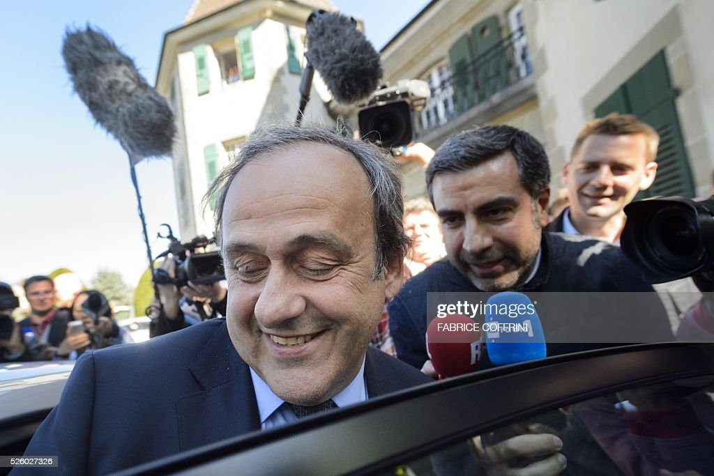 UEFA's fallen chief Michel Platini enters his car as he leaves the Court of Arbitration for Sport (CAS) after his appeal hearing against his six-year FIFA ban for ethics violations, on April 29, 2016 in Lausanne. CAS will rule on Michel Platini's appeal against his six-year FIFA ban by May 9, the head of the Lausanne-based tribunal Mathieu Reeb said on April 29. / AFP / FABRICE